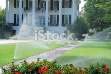 stock-photo-7390354-watering-the-lawn